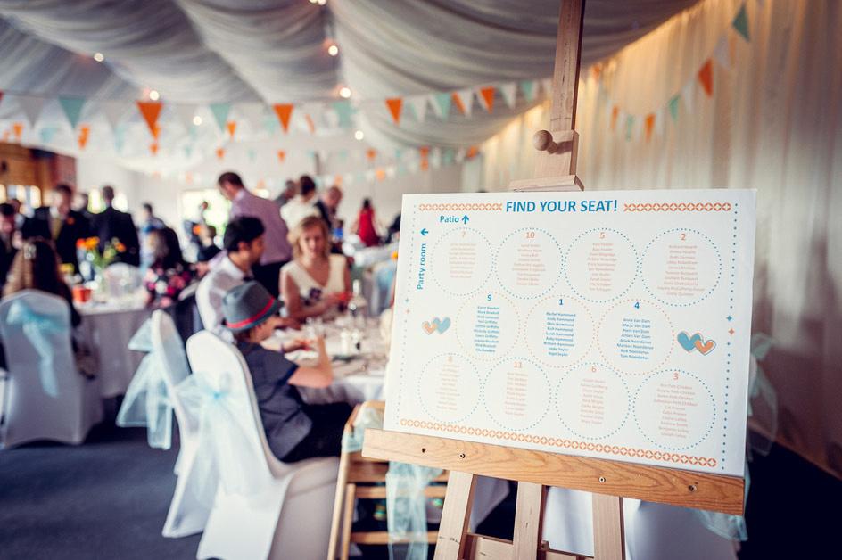 orange and blue wedding table plan