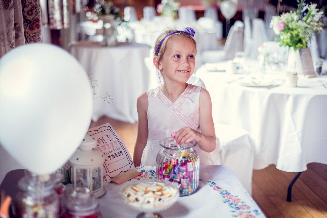 girl at wedding sweet table