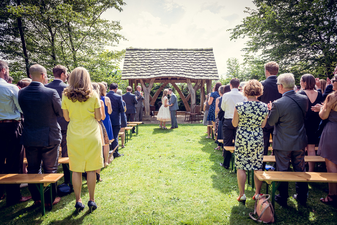first kiss at outdoor ceremony at Cripps Barn wedding