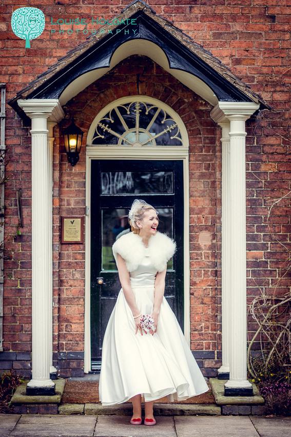 glamorous vintage bride laughing at Mythe Barn in Warwickshire