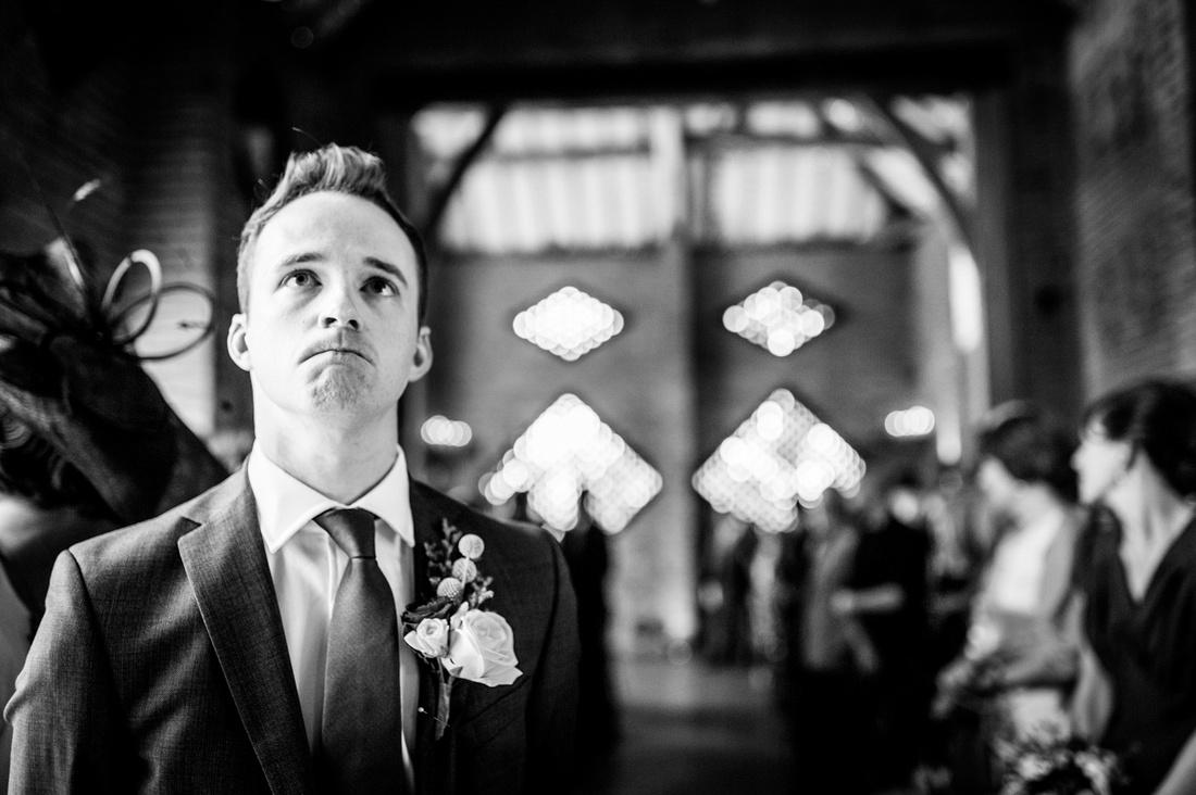 groom waiting nervously at Shustoke Farm Barns wedding