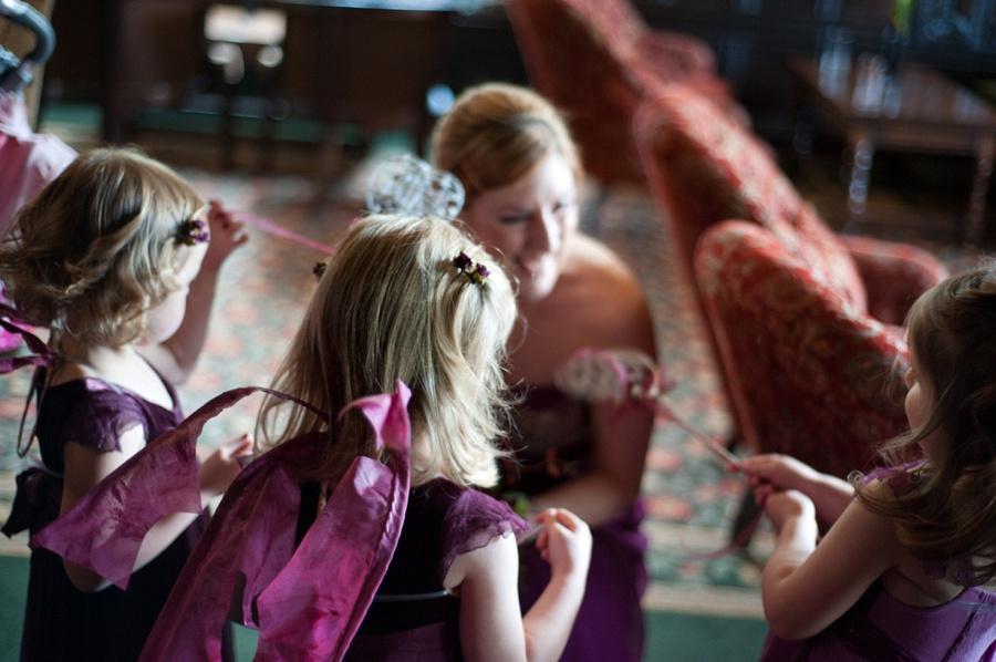 bridesmaid purple fairy wings New Hall Sutton Coldfield Birmingham documentary wedding photography