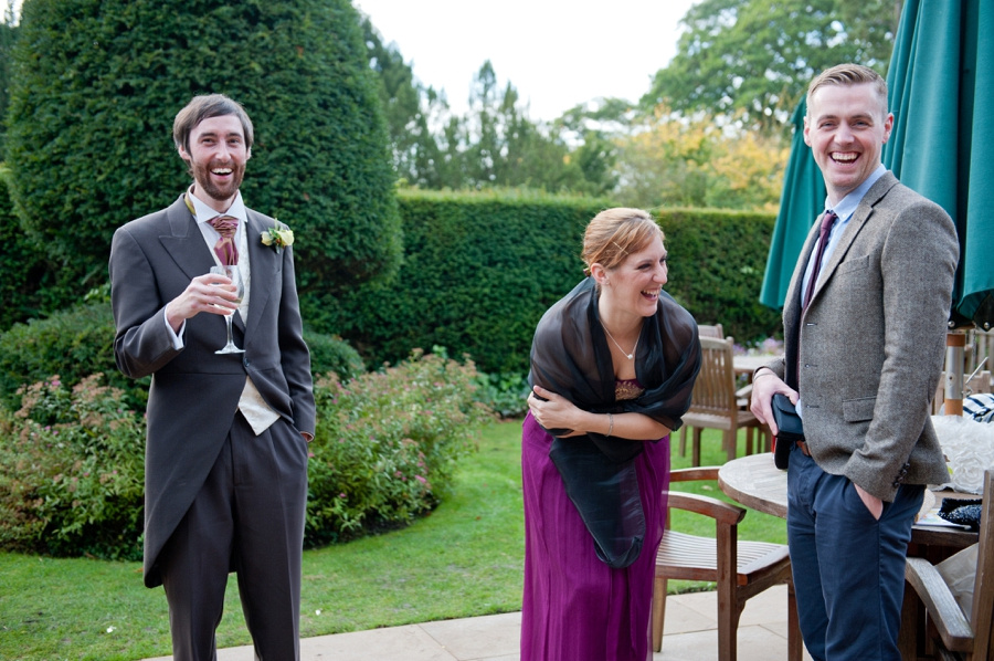 guests laughing wedding reception New Hall Sutton Coldfield reportage photography