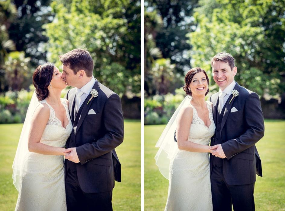 Bride and Groom kissing  in Castle Deudraeth gardens