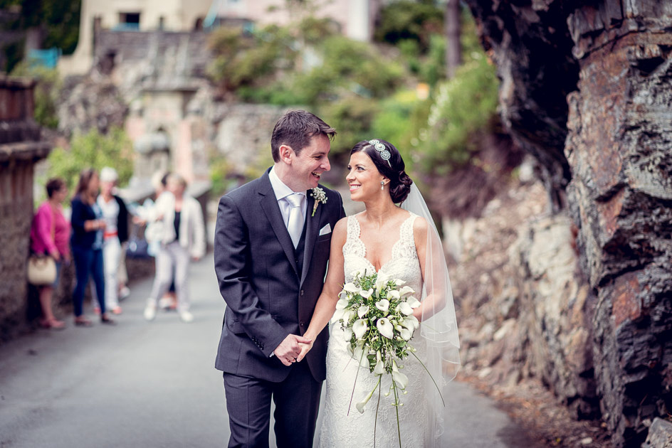 Newlyweds walk in Portmeirion