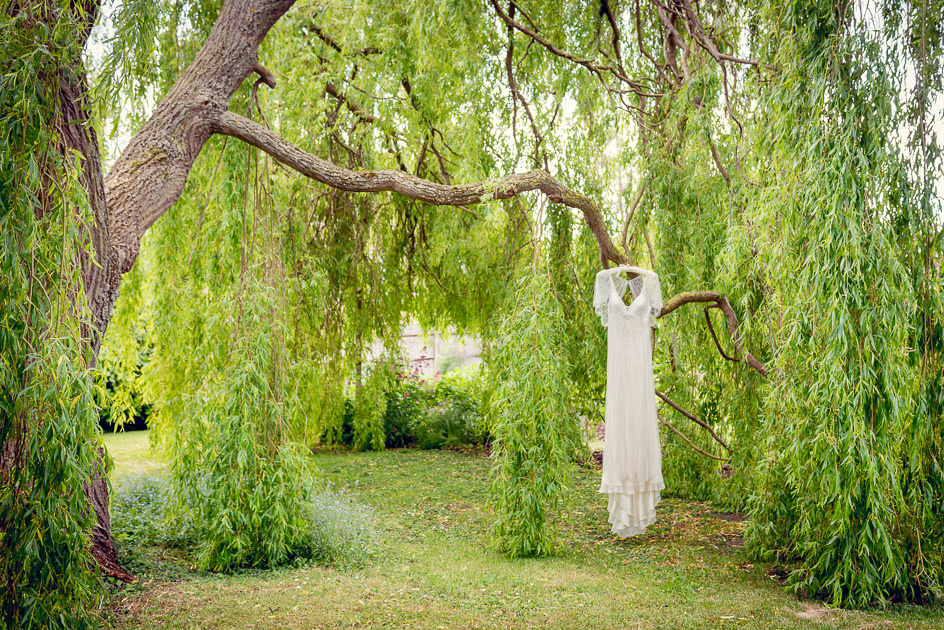 Jenny Packham dress hanging in a willow tree