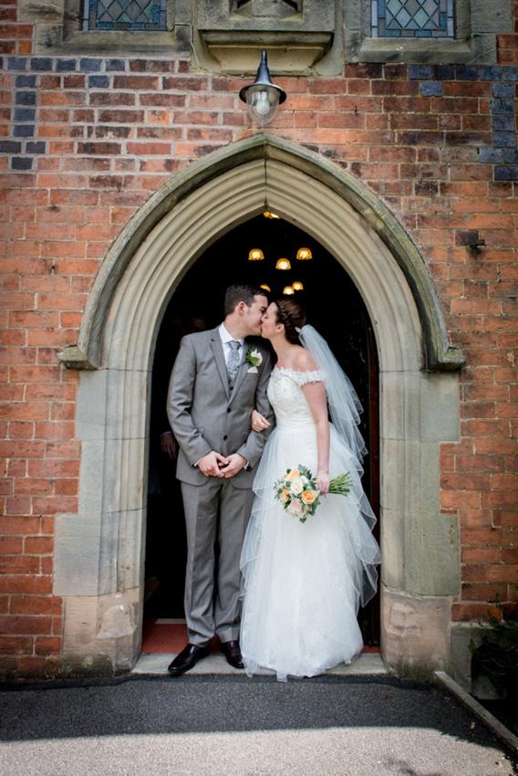 bride, groom, kissing, church, door, Warwickshire, wedding
