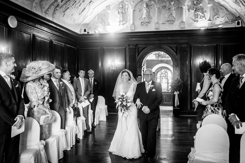 Bride walking into Portmeirion's Hercules Hall