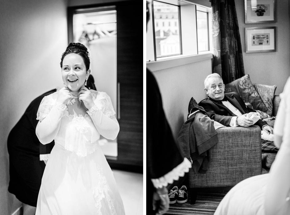 bride puts on vintage wedding dress while father watches