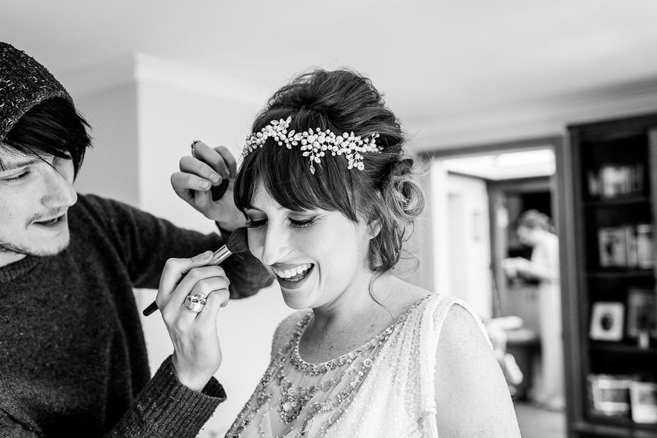 Finishing touches for beautiful bride in Jenny Packham wedding dress