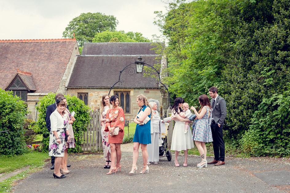 Wedding guests outside St Leonard's Church Beoley Redditch