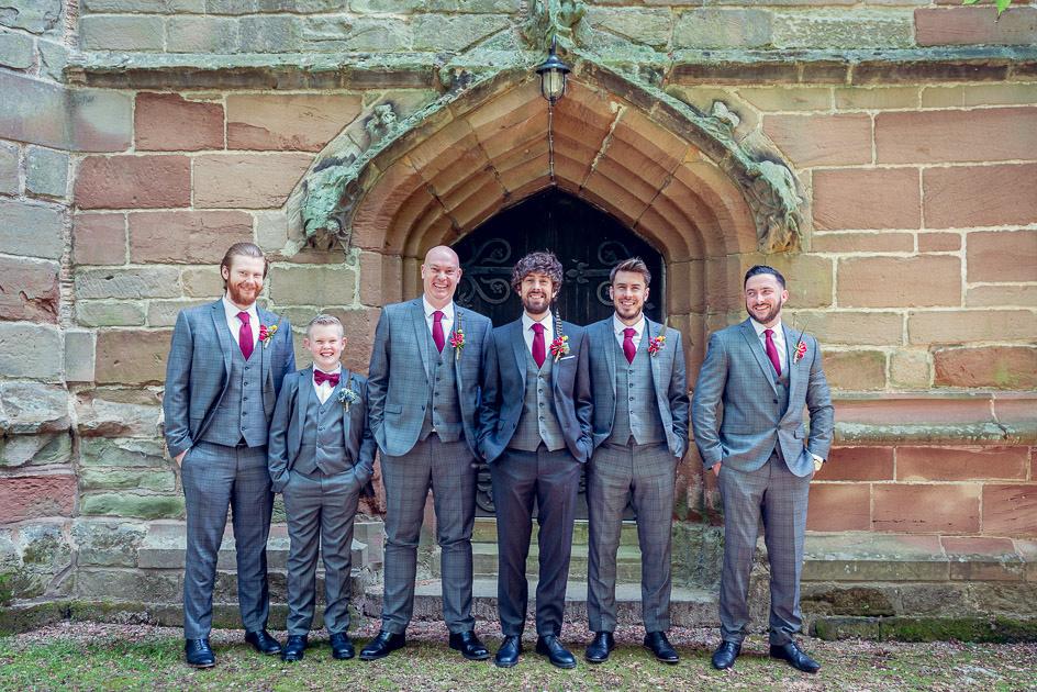 groom and groomsmen outside St Leonard's Church Beoley Redditch