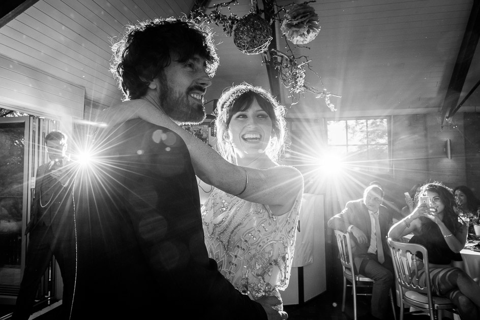 bride and groom smile before first dance at Gorcott Hall