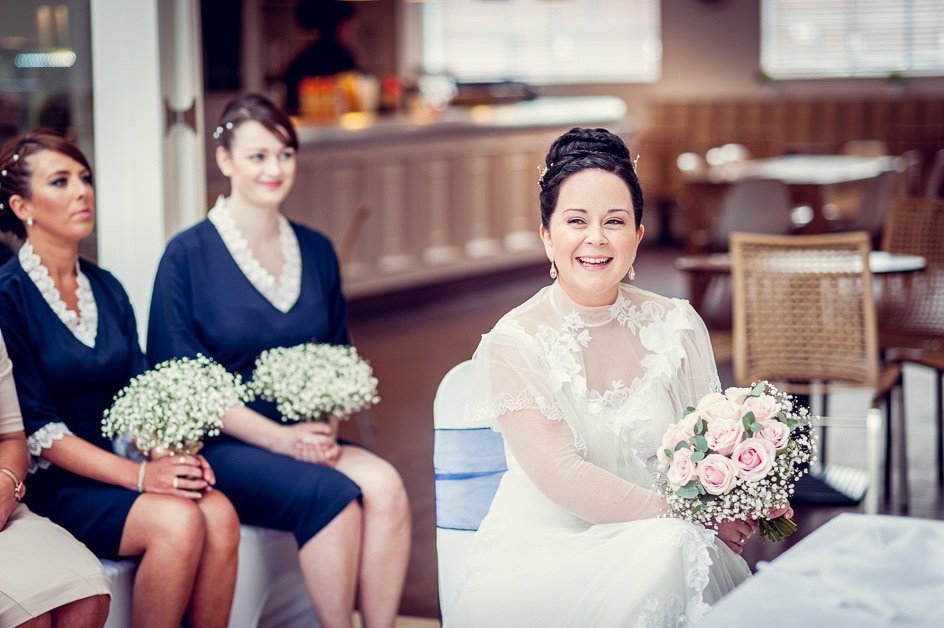 beautiful bride in a vintage dress with pink rose bouquet