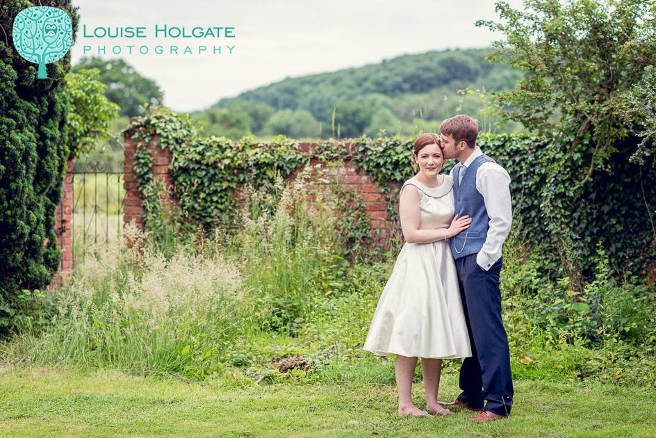 vintage style bride and groom in garden at Wootton Park in Warwickshire