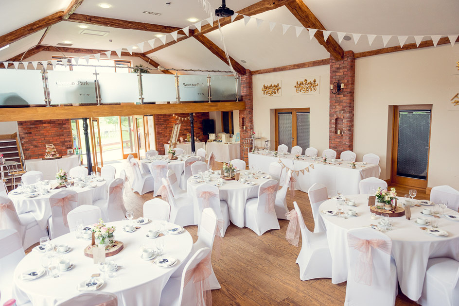 Wootton Park barn set up for wedding breakfast in a rustic vintage style