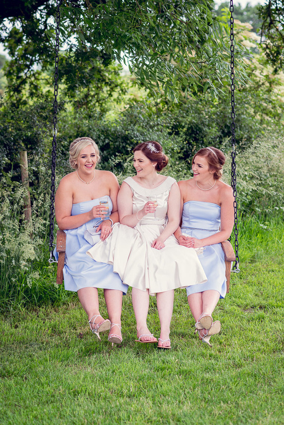 bride and bridesmaids on swing at Wootton Park wedding