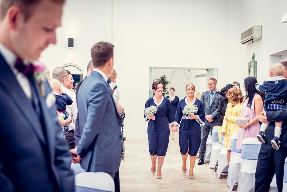 bridesmaids walk down aisle at Fazeley Studios