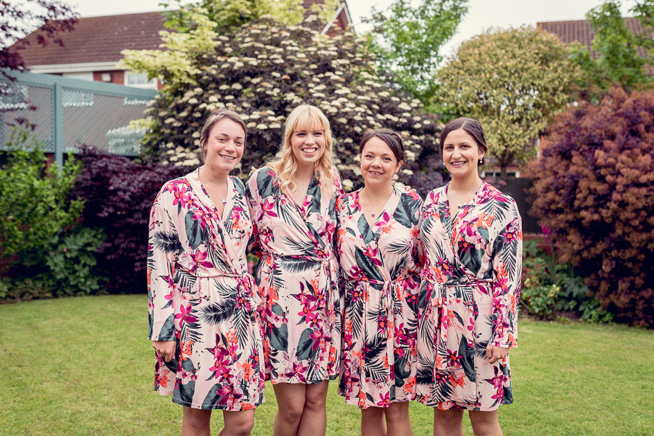 bride and bridesmaids in matching dressing gowns