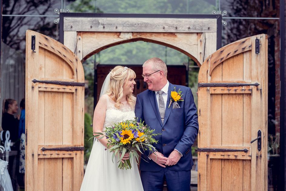 bride with dad before wedding at Shustoke Farm Barns in Warwickshire