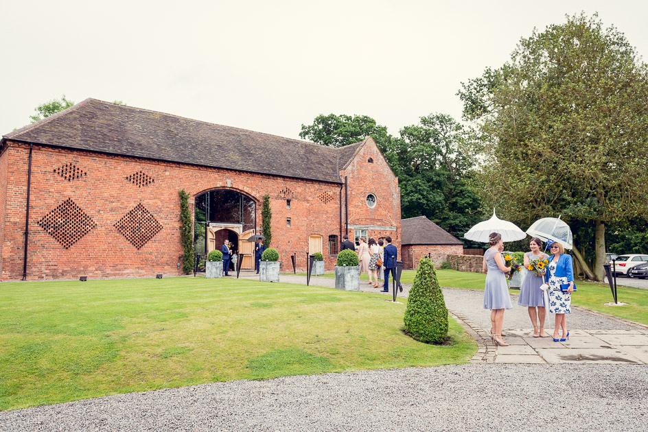 bridesmaids wait for bride to arrive at Shustoke Farm Barns in Warwickshire