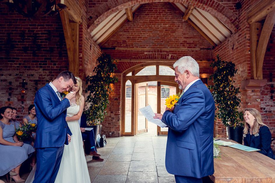 groom cries as dad does reading at Shustoke wedding