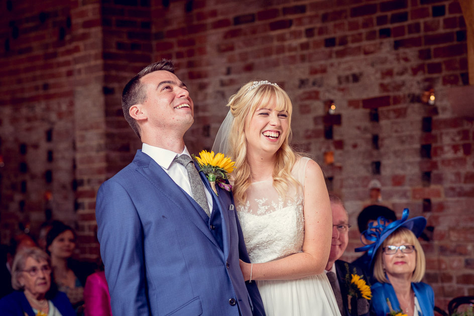 bride and groom laughing during at Shustoke ceremony