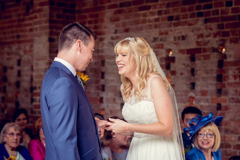 laughing bride and groom portrait during ceremony at Shustoke Farm Barns