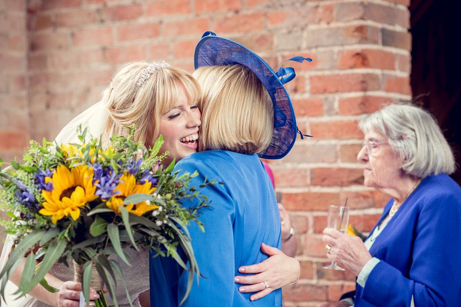 bride hugs mum