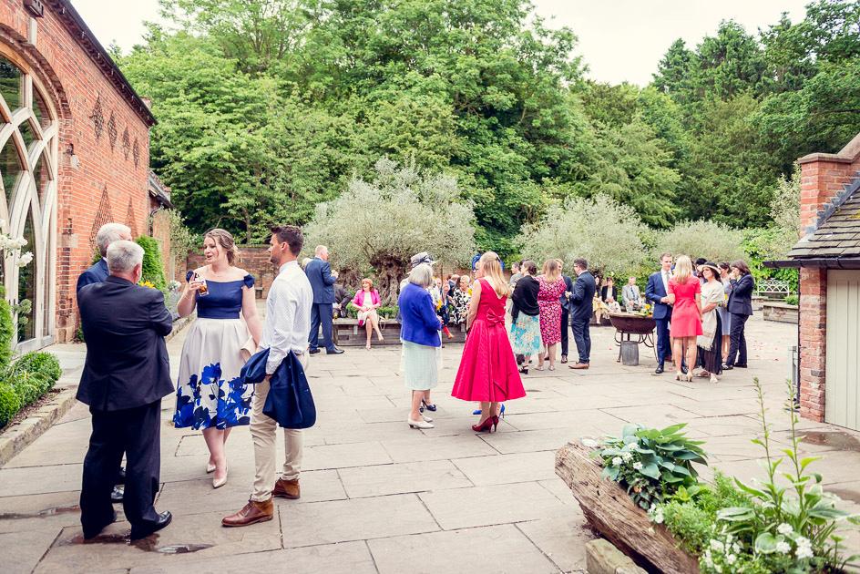 drinks reception in courtyard at Shustoke Farm Barns