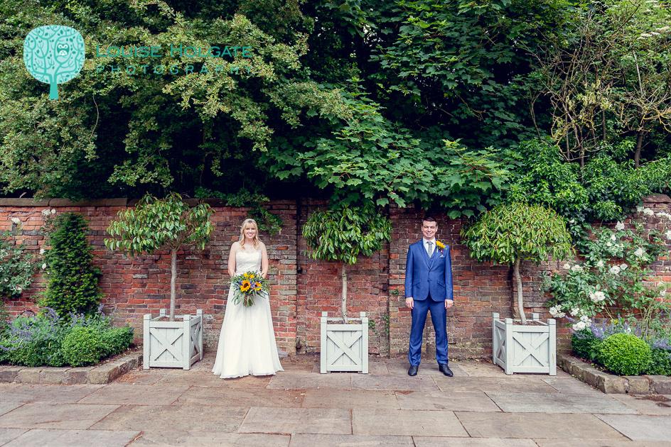 bride and groom portrait in courtyard at Shustoke Farm Barns in Warwickshire
