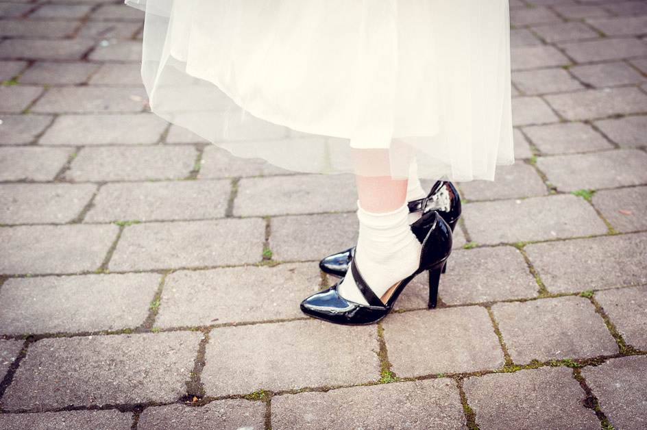 bridesmaid wearing grown up shoes