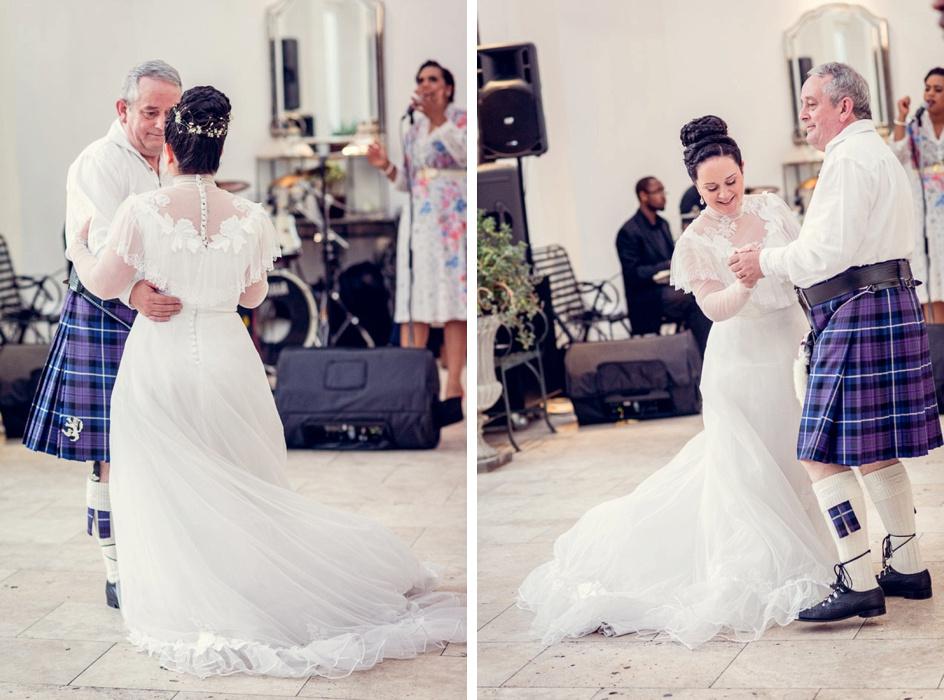 bride in vintage dress dances with dad in kilt