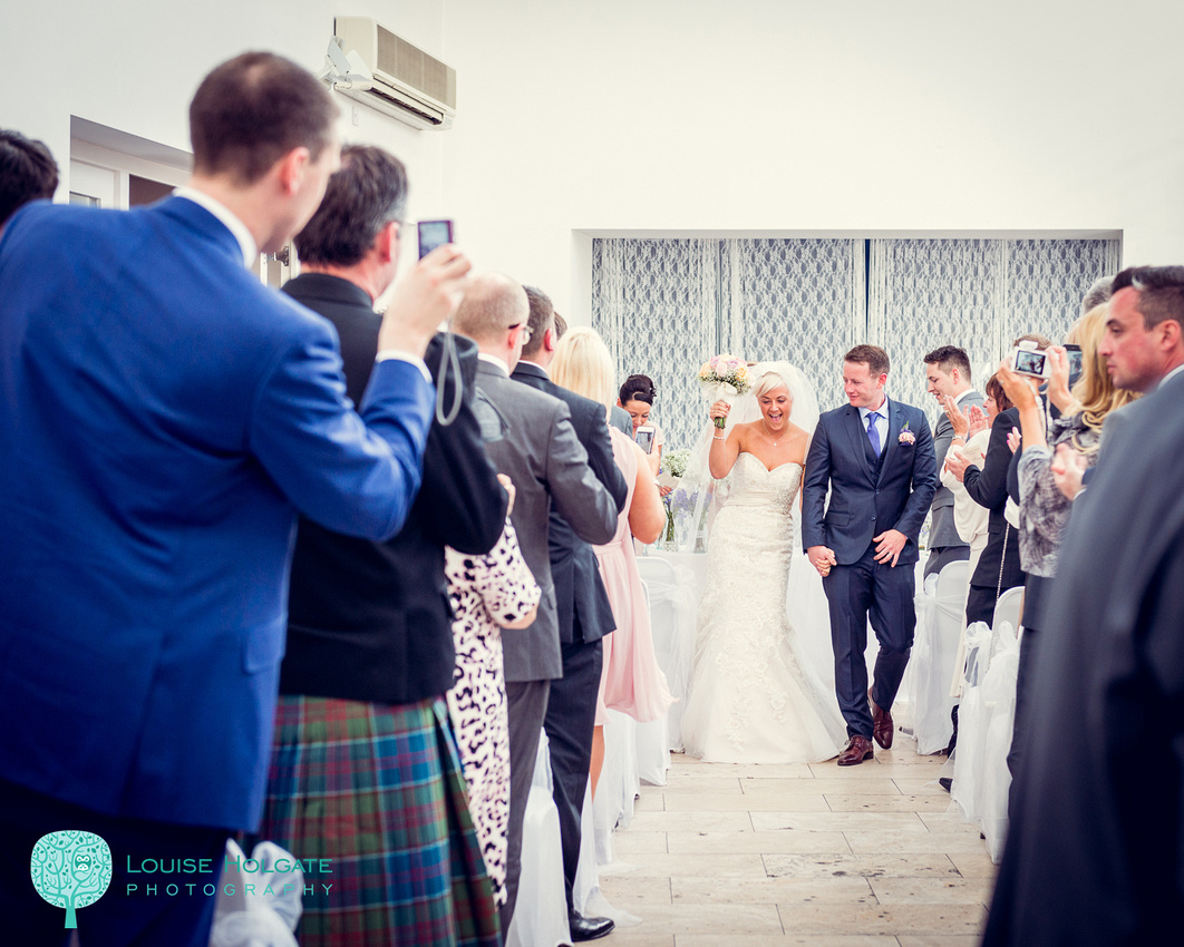 bride and groom walking down aisle after ceremony at Fazeley Studios in Birmingham