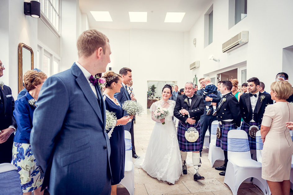bride and groom see each other for the first time at Fazeley Studios