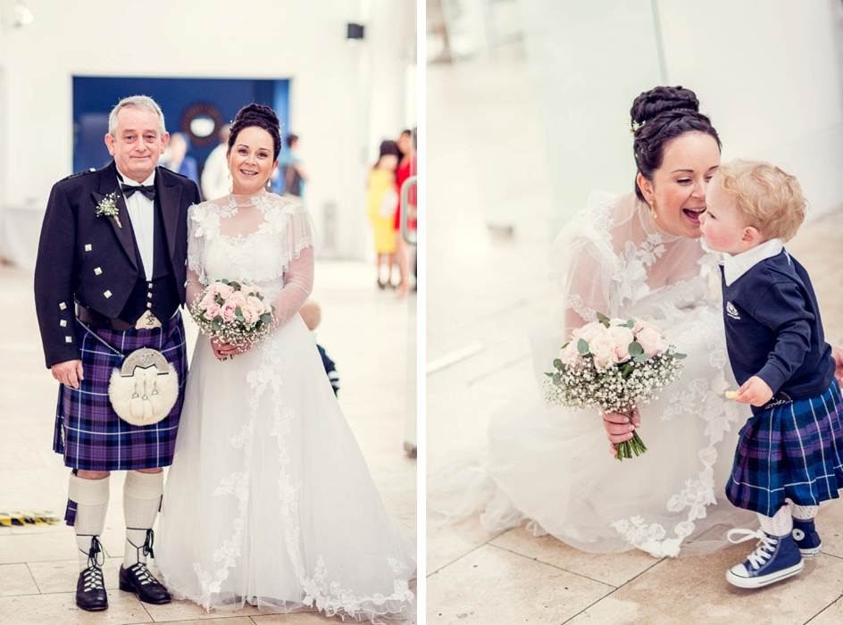 bride in vintage wedding dress with proud dad and son in kilts