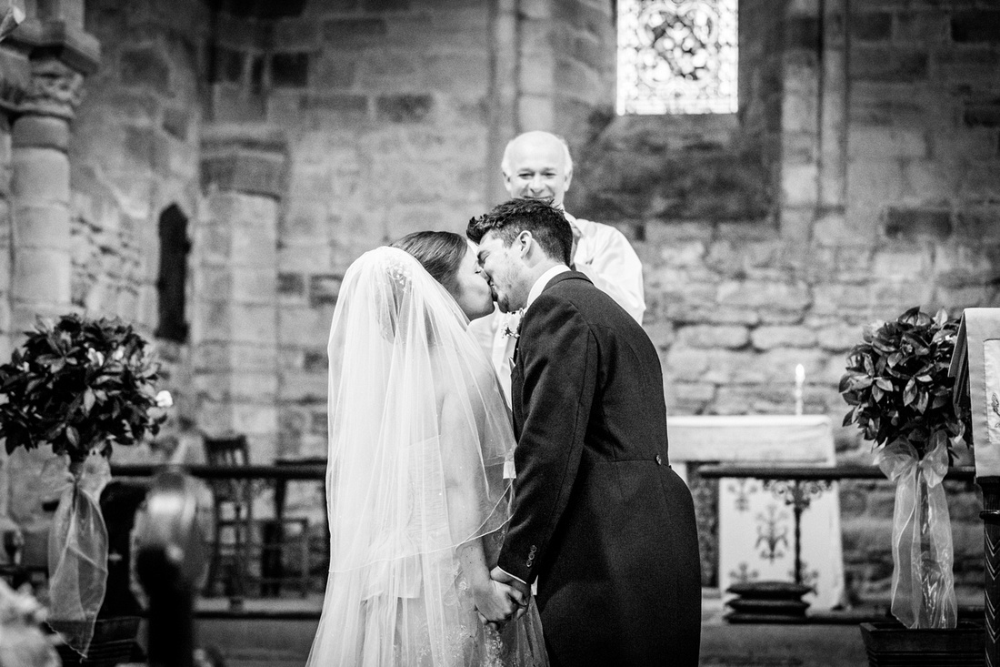 first kiss at Warwickshire church wedding
