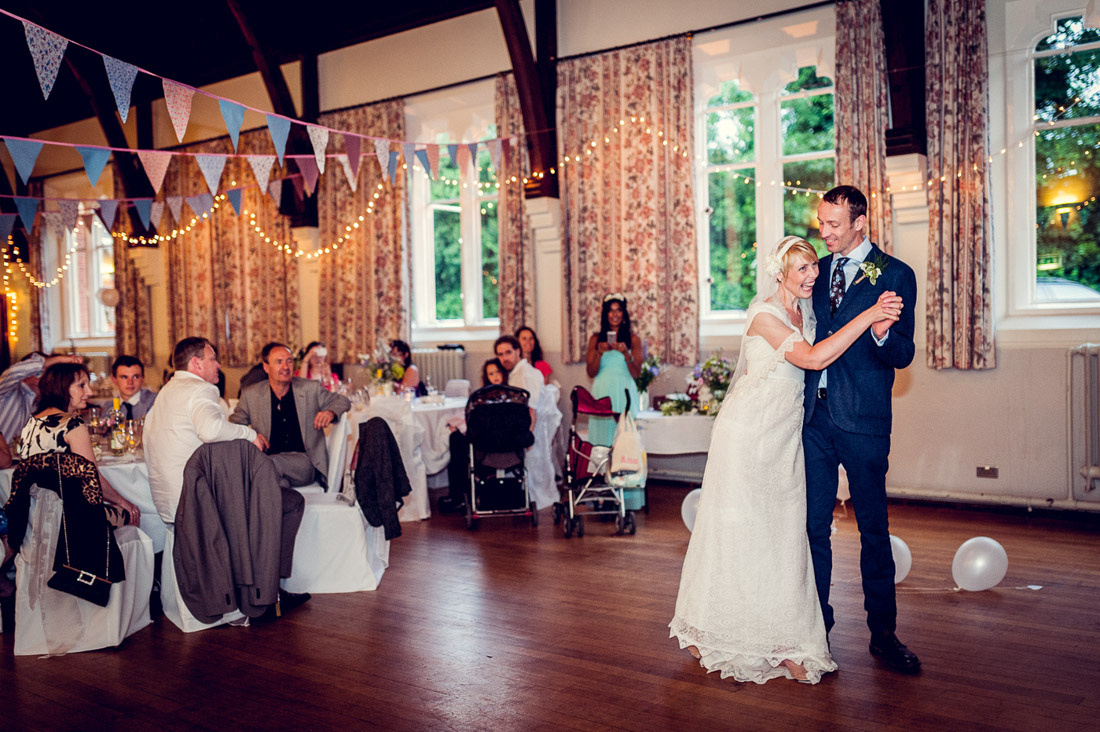 bride and groom laughing during first dance at Hatton Village Hall
