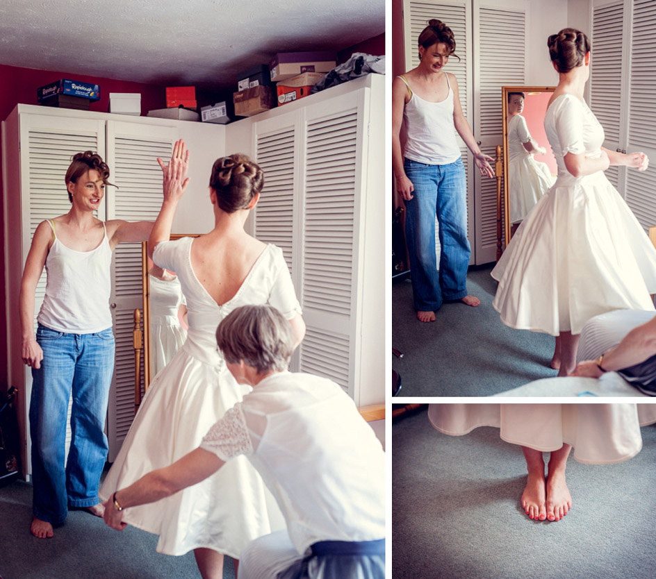 bride looks at herself in her vintage style short dress