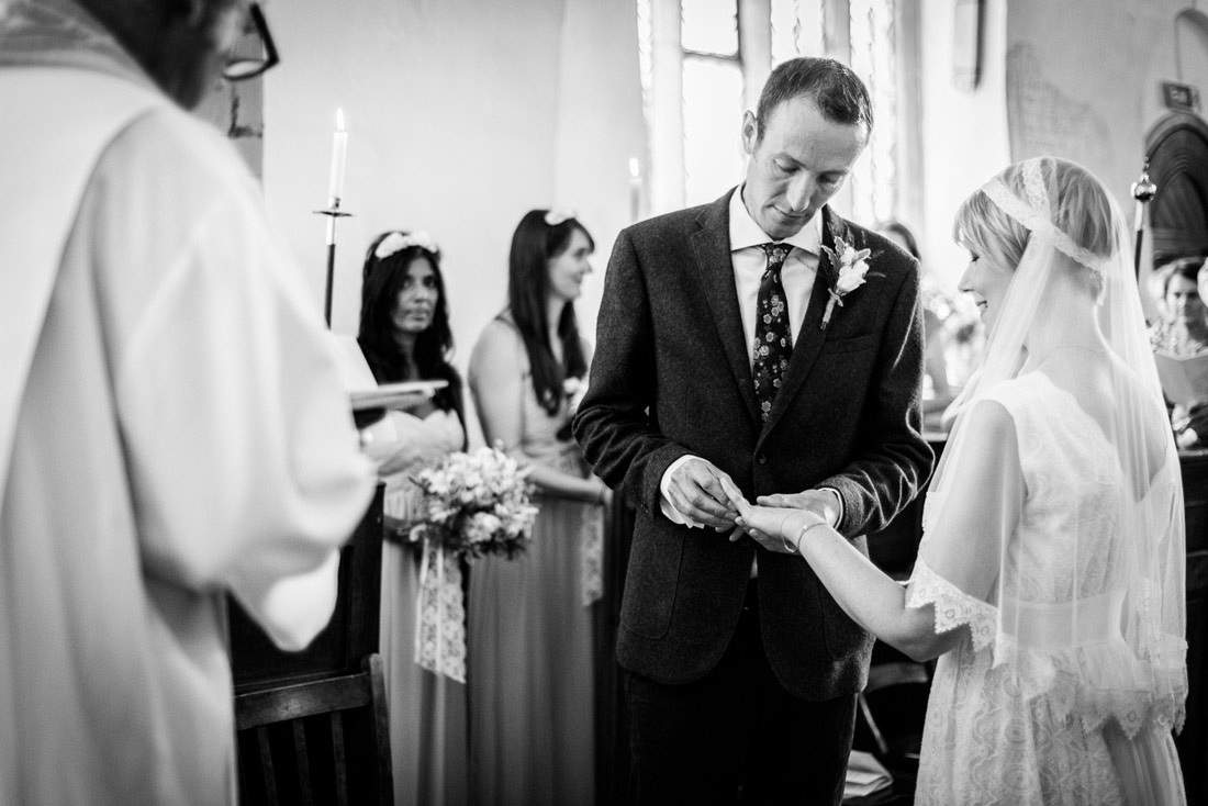 bride and groom exchange rings St Mary's Church Hatton Warwickshire
