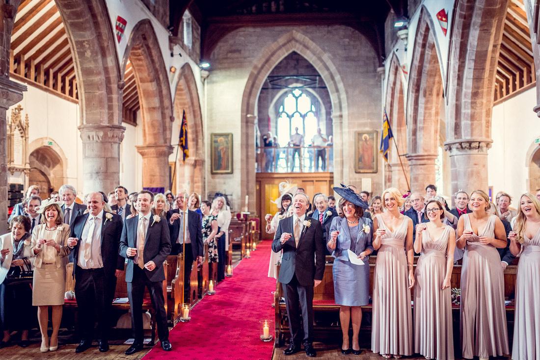 guests sing sto-lat at wedding