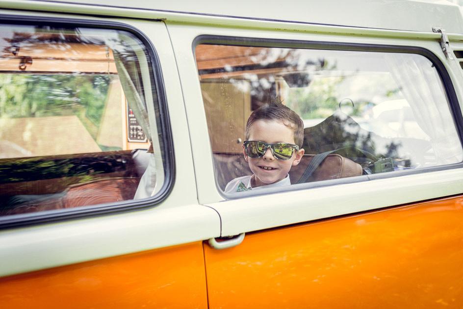 page boy in orange VW vintage camper van