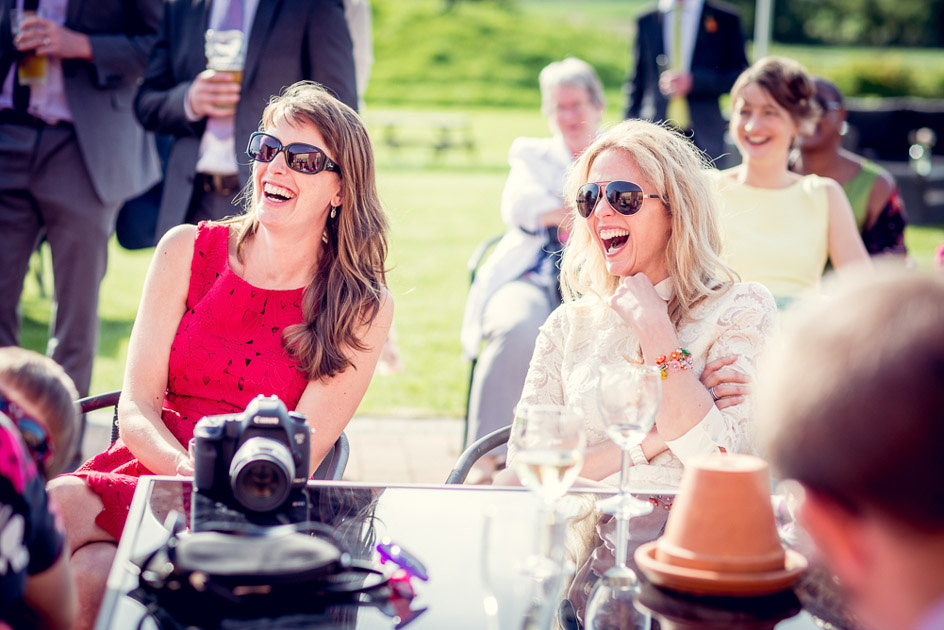 guests laughing at speeches outdoors at Warwickshire wedding
