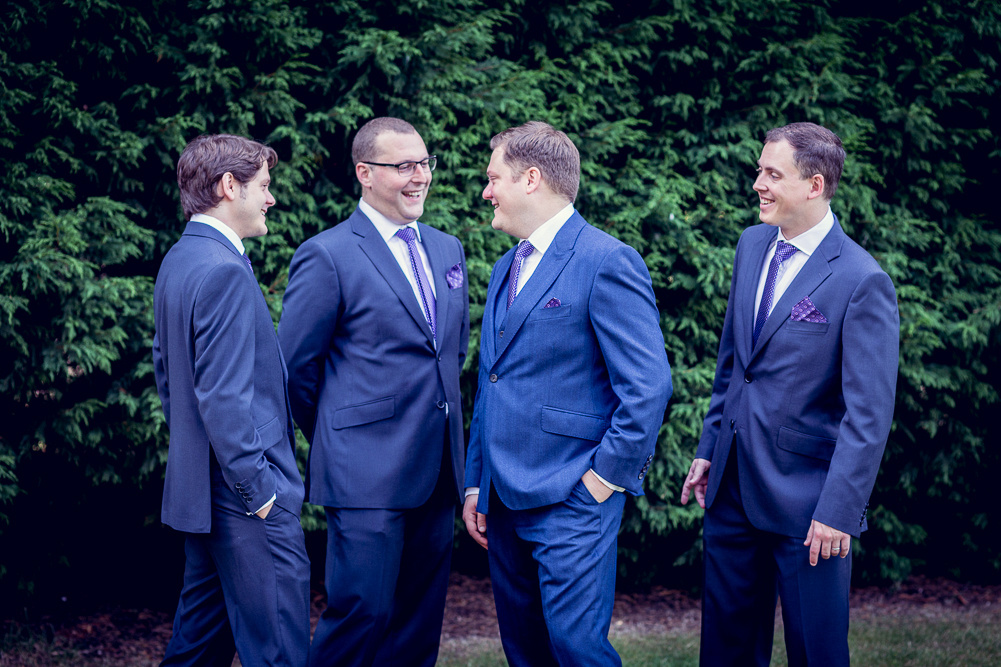groom and groomsmen laughing before wedding