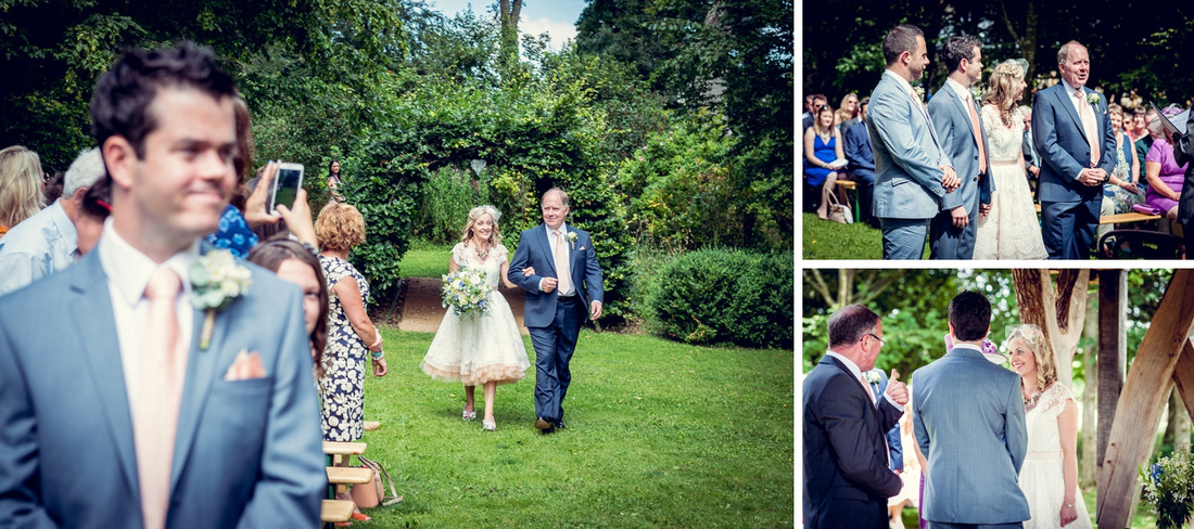 bride walking down the aisle for outdoor ceremony at Cripps Barn