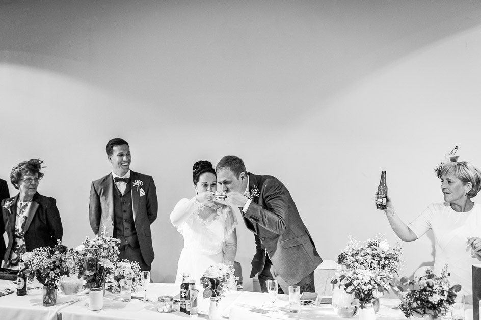 bride and groom drink whisky during speeches