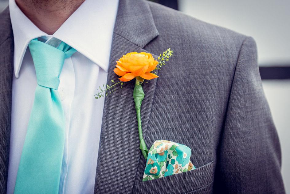 orange ranunculus buttonhole and liberty print pocket square