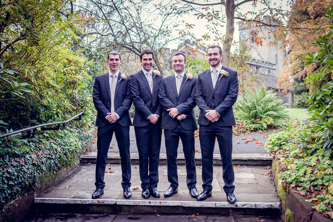 groom and groomsmen before wedding at St Mary and St Bartholomew church in Hampton in Arden