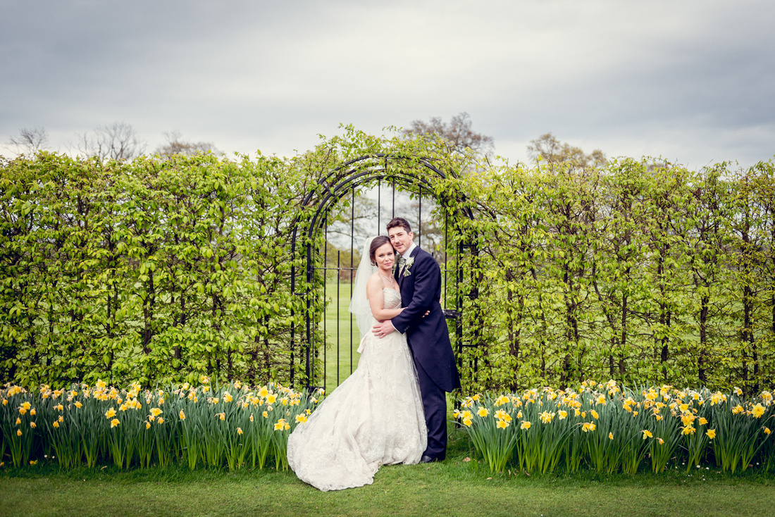 relaxed bride and groom portrait with daffodils at Ardencote Manor