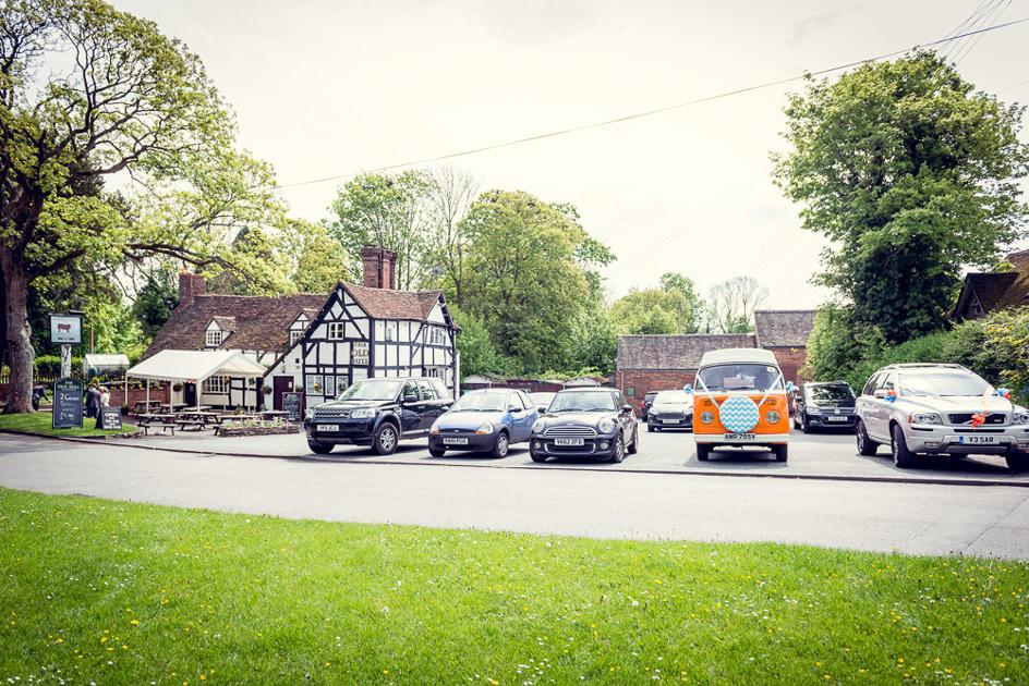 orange vintage VW camper van outside Old Bull pub in Inkberrow in Worcestershire